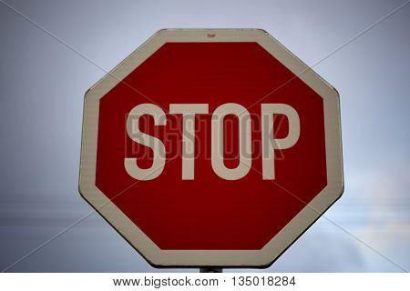stop sign near the road with on white