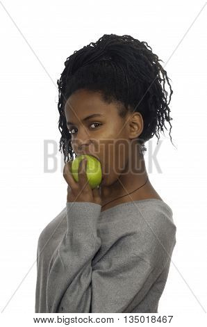 Teenage girl biting an apple  on white background