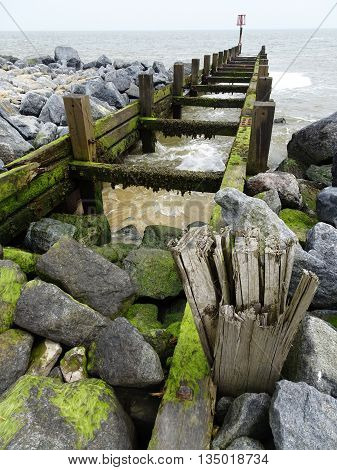 Dilapidated beach jetty seascape photographed at Hopton On Sea in Norfolk