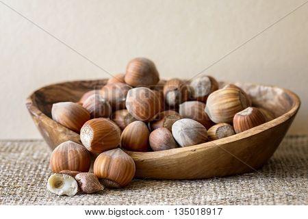 hazelnut in olive wood basket on jute