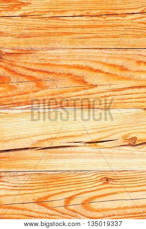 Textured wooden bar wall with cracked surface