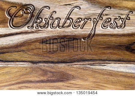 oktoberfest text carved on wood for background