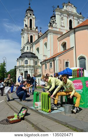 VILNIUS, LITHUANIA - MAY 17: Unidentified musician plays on metal radiators in Street music day on May 17, 2014 in Vilnius. Its a most popular event on May in Vilnius, Lithuania