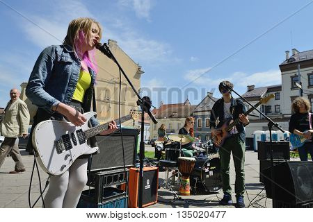 VILNIUS, LITHUANIA - MAY 17: Unidentified musician play guitar in Street music day on May 17, 2014 in Vilnius. Its a most popular event on May in Vilnius, Lithuania
