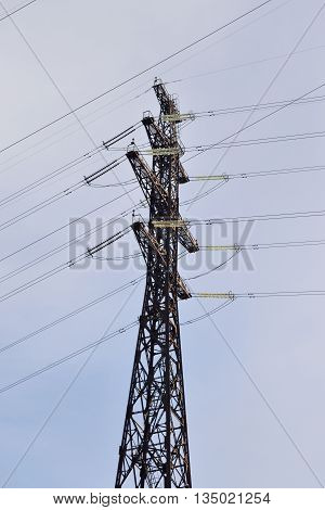 Transmission line on background of cloudy sky.