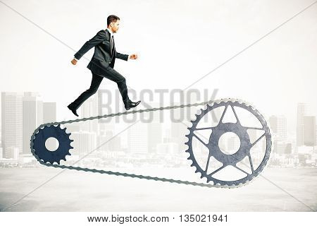 Bicycle gearing with running businessman on abstract city background. 3D Rendering