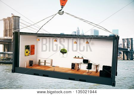 Abstract office interior inside black crago container suspended on crane hook on city background. 3D Rendering