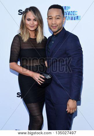 LOS ANGELES - JUN 14:  Chrissy Teigen & John Legend arrives to the