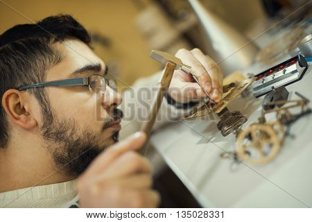 Watchmaker at work.Old pocket watch being repaired by watch maker.