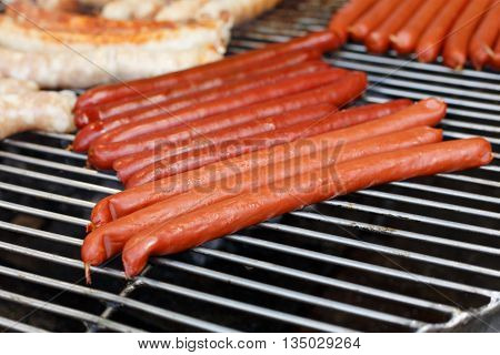 Barbecue large grill outdoors. Cookout bbq food. Big roasted pork bratwurst german sausages
