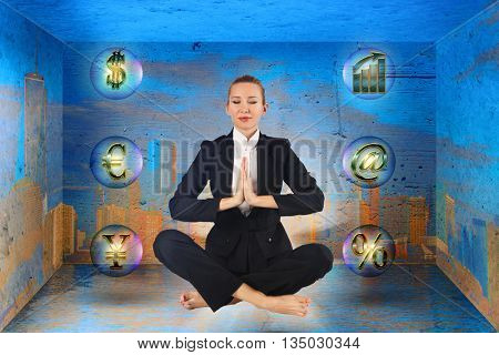Businesswoman meditating in the box