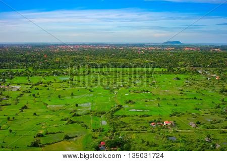 Aerial view of Siem Reap city and green fields, Angkor area, Cambodia, Southeast Asia