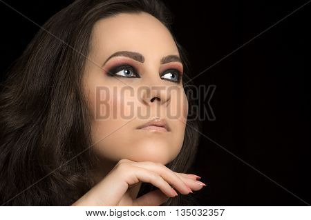 Beauty portrait about woman with blue eyes and light pink makeup.