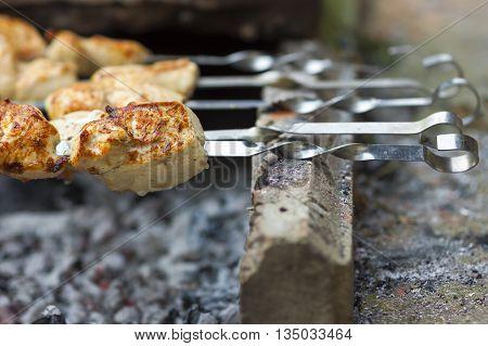 close-up of tasty shish kebabs on skewers
