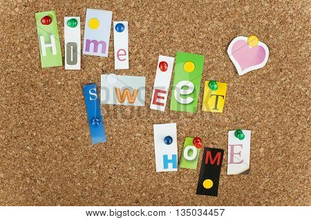 Home sweet home sign on cork board