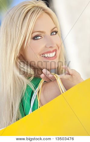 Young Blond Woman With Blue Eyes And Shopping Bags