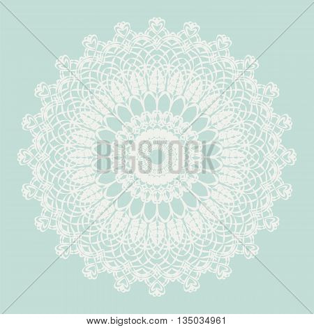 Delicate crochet lace round ornament in blue. Vector