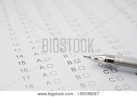 test score sheet with answers and ballpoint close up
