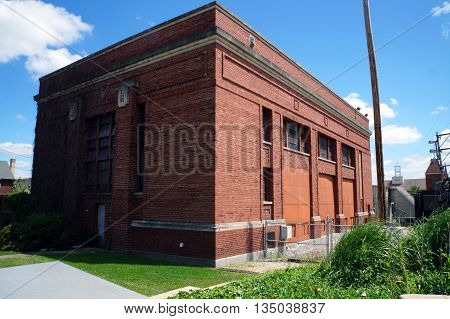 JOLIET, ILLINOIS / UNITED STATES - JUNE 1, 2015: A brick building, belonging to Commonwealth Edison, in downtown Joliet.