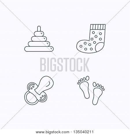 Footprint, pacifier and socks icons. Pyramid toy linear sign. Flat linear icons on white background. Vector