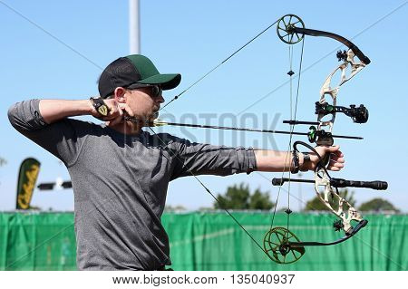 ARLINGTON, TX - APR 18: Recording artist Justin Moore paticipates at the ACM & Cabela's Great Outdoor Archery Event at the Texas Rangers Youth Ballpark on April 18, 2015.
