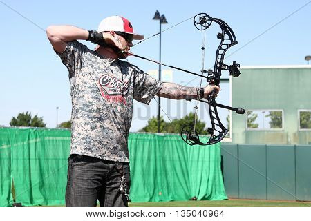 ARLINGTON, TX - APR 18: Recording artist Brantley Gilbert participates at the ACM & Cabela's Great Outdoor Archery Event at the Texas Rangers Youth Ballpark on April 18, 2015.