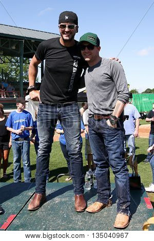 ARLINGTON, TX - APR 18: Recording artists Luke Bryan (L) and Justin Moore at the ACM & Cabela's Great Outdoor Archery Event at the Texas Rangers Youth Ballpark on April 18, 2015.