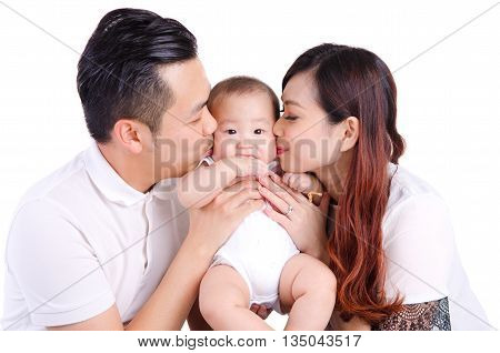 Asian parent kiss their six months old baby boy
