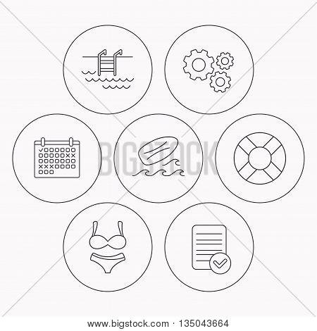 Surfboard, swimming pool and bikini icons. Lifebuoy linear sign. Check file, calendar and cogwheel icons. Vector