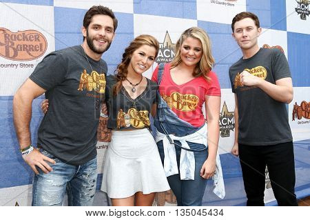 ARLINGTON, TX - APR 18:(L-R)Cassadee Pope, Thomas Rhett, Lauren Alaina & Scotty McCreery at the Cracker Barrel Checkers Challenge at Globe Life Park in Arlington on April 18, 2015 in Arlington, Texas.