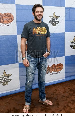 ARLINGTON, TX - APR 18: Singer Thomas Rhett attends the Cracker Barrel Old Country Store Country Checkers Challenge at Globe Life Park in Arlington on April 18, 2015 in Arlington, Texas.