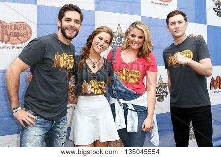 ARLINGTON, TX - APR 18 (L-R)Cassadee Pope, Thomas Rhett, Lauren Alaina & Scotty McCreery at the Cracker Barrel Checkers Challenge at Globe Life Park in Arlington on April 18, 2015 in Arlington, Texas.