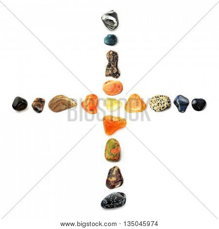 Cross of gems - Composition of semi-precious gemstones, isolated on white background, symbolizing Sacred Heart of Jesus Christ