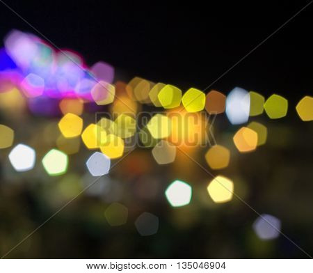 Abstract yellow and violet night lights with blurred background