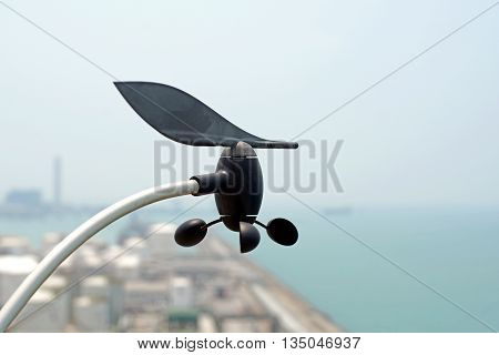 closeup of anemometer against blue sky background
