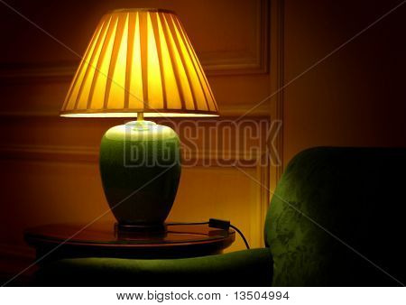 table lamp and sofa with wooden background
