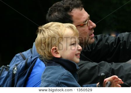 Father And Son Watching And Pointing At Something In The Distant