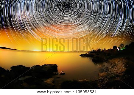 beautiful sky at night with startrails and lake