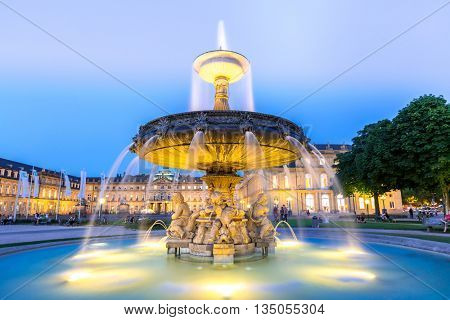 Fountain at neues Schloss New palace in Stuttgart city center, Germany at dusk
