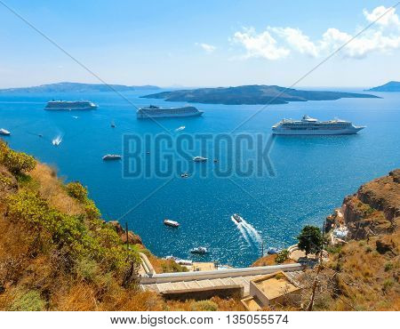 Santorini, Greece - June 10, 2015: The beautiful view of marina bay with cruise ships at the sea