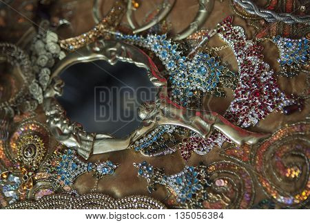 Antique Mirror and Golden Luxury Oriental Jewelry and Accessories: Female Hands with beautiful National Indian Jewellery Eastern Fairy Tale Wedding Fashion and Beauty. Eastern Treasure Chest