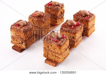 Home made chocolate cream layer cakes in white background,.