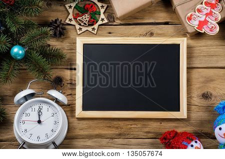 Small chalkboard for message with christmas decoration top view. Christmas background. Vintage rustic style.