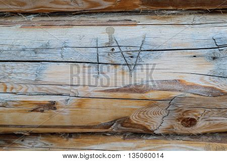 Roman numeral four on wooden background with copyspace