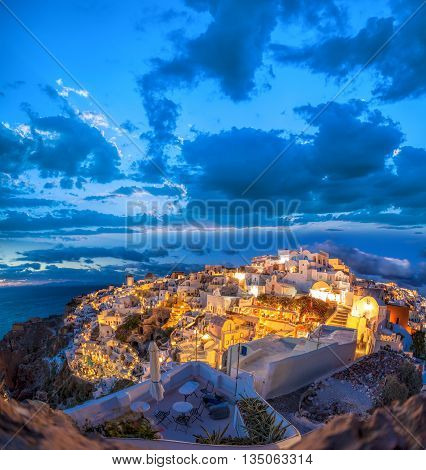 Oia Village In The Evening On Santorini Island In Greece