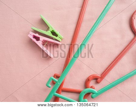 Peg clothes and Clothes Hanger on fabric pink