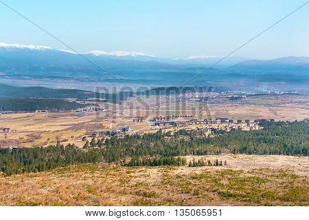 Pirin Golf aerial view with pine trees and mountains near Bansko, Bulgaria