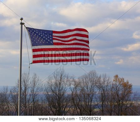 American flag flying in a breeze on the Blue Ridge overlooking the Shenandoah Valley