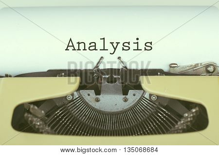 Analysis word on typewriter paper business concept