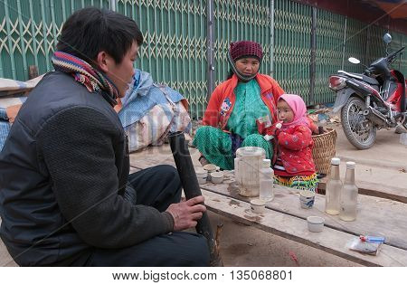 HA GIANG, VIETNAM, February 2, 2016 Hmong family, Ha Giang mountainous regions, they are happy with small children, bazaar Dong Van, Ha Giang mountainous region, Vietnam
